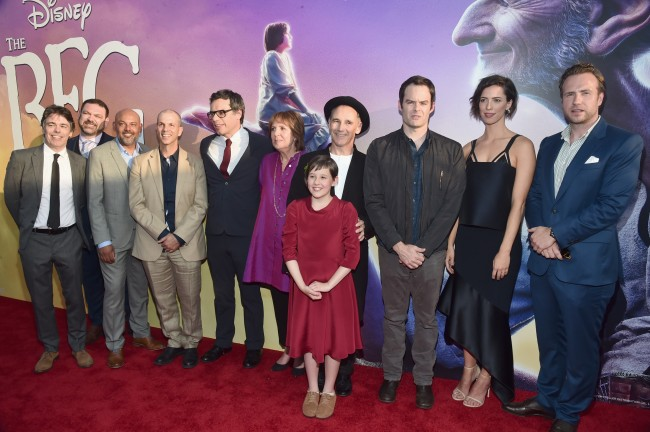 """HOLLYWOOD, CA - JUNE 21: (L-R) Actors Jonathan Holmes, Paul Moniz de Sa, Daniel Bacon, Chris Gibbs, Jemaine Clement, Penelope Wilton, Mark Rylance, Ruby Barnhill, Bill Hader, Rebecca Hall and Rafe Spall arrive on the red carpet for the US premiere of Disney's """"The BFG,"""" directed and produced by Steven Spielberg. A giant sized crowd lined the streets of Hollywood Boulevard to see stars arrive at the El Capitan Theatre. """"The BFG"""" opens in U.S. theaters on July 1, 2016, the year that marks the 100th anniversary of Dahl's birth, at the El Capitan Theatre on June 21, 2016 in Hollywood, California. (Photo by Alberto E. Rodriguez/Getty Images for Disney) *** Local Caption *** Jonathan Holmes; Paul Moniz de Sa; Daniel Bacon; Chris Gibbs; Jemaine Clement; Penelope Wilton; Mark Rylance; Ruby Barnhill; Bill Hader; Rebecca Hall; Rafe Spall"""